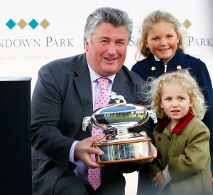 Paul Nicholls celebrates winning the national hunt trainers' championship at Sandown on Saturday. Pic: John Hoy (Courtesy of Sandown Park.)