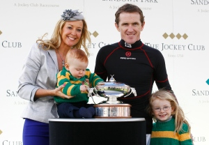 Tony McCoy is joined by his family as he is awarded the national hunt jockeys' title for the 19th successive year, at Sandown. Pic: John Hoy (Courtesy Sandown).