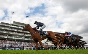 Ruler of the World ridden by Ryan Moore wins the 2013 Investec Derby. Pic: Courtesy of Epsom Downs.
