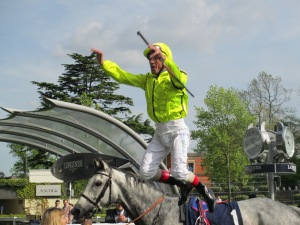 Frankie Dettori delights racegoers with a flying dismount after winning the Longines Sagaro Stakes on Tac De Boistron at Ascot.