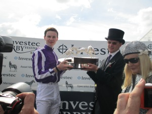 Joseph O'Brien and his father, trainer Aidan O'Brien lift the trophy after winning the 2014 Investec Derby with Australia.