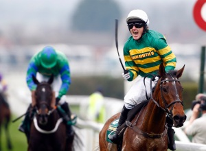 Tony McCoy bids to follow up on his 2010 win on Don't Push It in the Grand National Pic: Dan Abraham – racingfotos.com