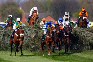 Ballabriggs and Jason Maguire jumping the chair (yellow and green and white) winning The John Smith's Grand National  Pic: Dan Abraham - racingfotos.com