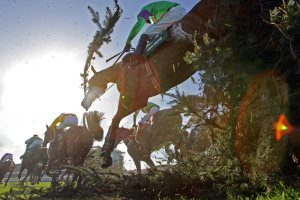 Mon Mome and Liam Treadwell jumping the chair on his way to winning The John Smith's Grand National Pic Dan Abraham - racingfotos.com
