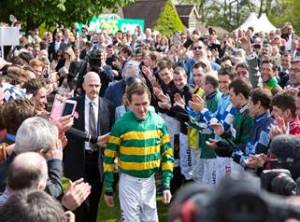Tony McCoy received a terrific send-off from racegoers as Sandown where he was awarded a the jockeys' title on the day he retired from race-riding. Pic: Great British Racing.