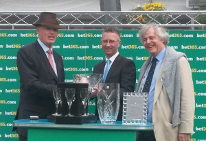 John Gosden (left) and winning connections after Western Hymn's victory.f