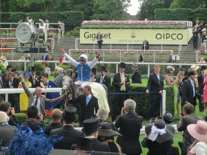 Maxime Guyon celebrates after winning the Queen Anne Stakes on Solow.