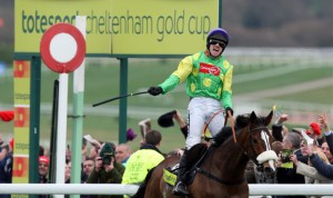 Ruby Walsh celebrates after winning the Cheltenham Gold Cup on Kauto Star.