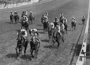 Roberto (second l), ridden by Lester Piggott, pips Rheingold (l), ridden by Ernie Johnson, to the post to win the Derby