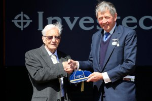 Chairman of Epsom Downs Racecourse Anthony Cane presents Lester Piggott with the Investec Derby Cap. Pic: Courtesy of Jockey Club Racecourses.