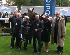 Dermot Weld (right) and winning connections after the victory of Forgotten Voice in the Qipco Champion Stakes.